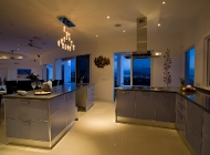 View of Gourmet Kitchen at St Lucia\'s Best Holiday Villa Rental Towards Dining Terrace
