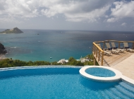 View from St Lucia\'s Best Holiday Villa Rental Living Terrace towards Pigeon Island over the pool and Sun Deck