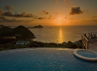 View from St Lucia\'s Best Holiday Villa Rental over the pool at Sunset