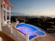 View from St Lucia\'s Best Holiday Villa Rental Dining Terrace over the pool towards Rodney Bay at sunset