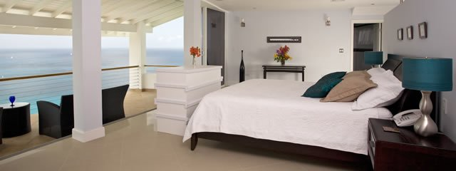 Akasha St Lucia Luxury Holiday Villa Rental and Caribbean's Best Villa Rental. Master Bedroom Suite with King bed, pop up tv, terrace with view to Pigeon Island and over Caribbean sea. Seating on terrace